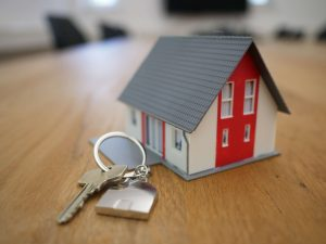 a small house keyring