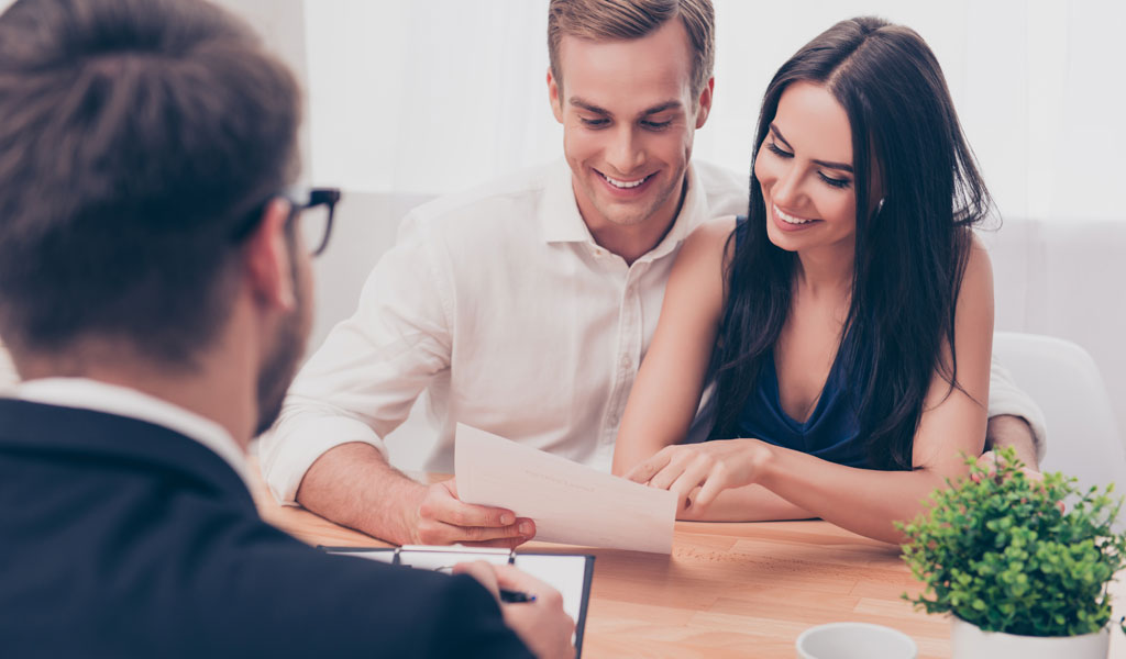 a-couple-reviewing-mortgage-documents