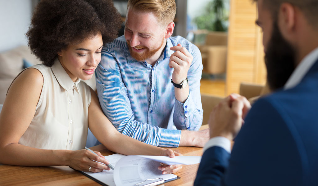 a-couple-signing-mortgage-documents