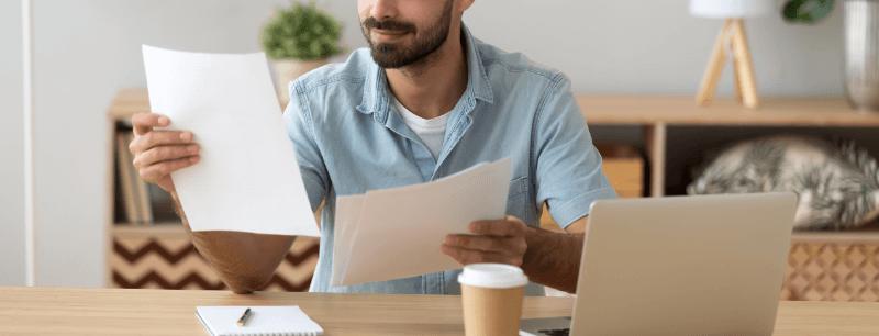man gathering mortgage documents