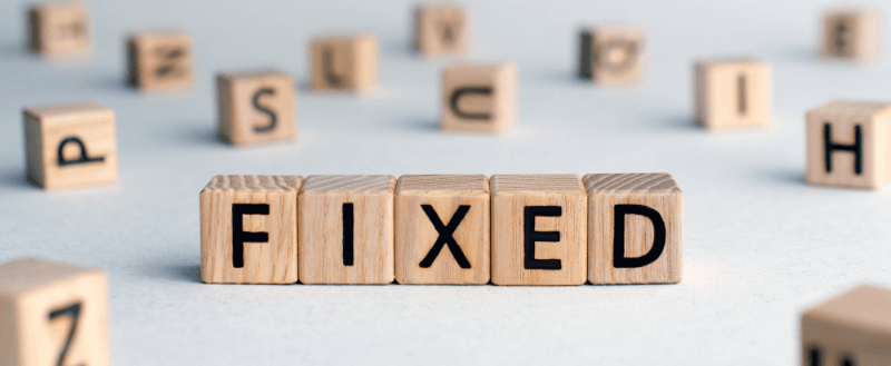 the word fixed spelt out in letter blocks - fixed mortgage concept