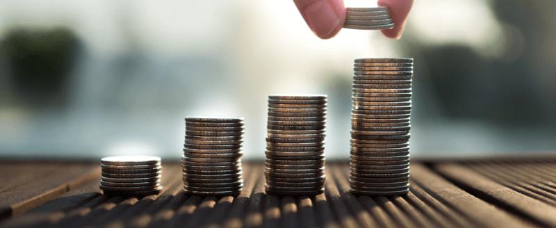 man counting his savings in pennies